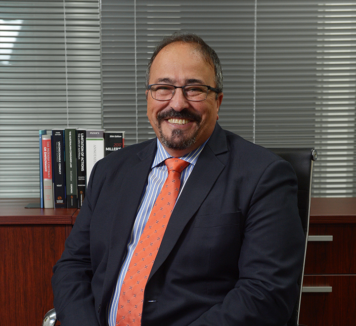 Experienced lawyer sitting in chair