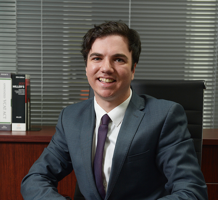 Young lawyer sitting in office